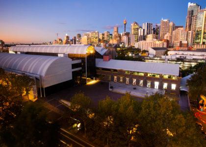 Powerhouse Museum and Sydney city skyline at night