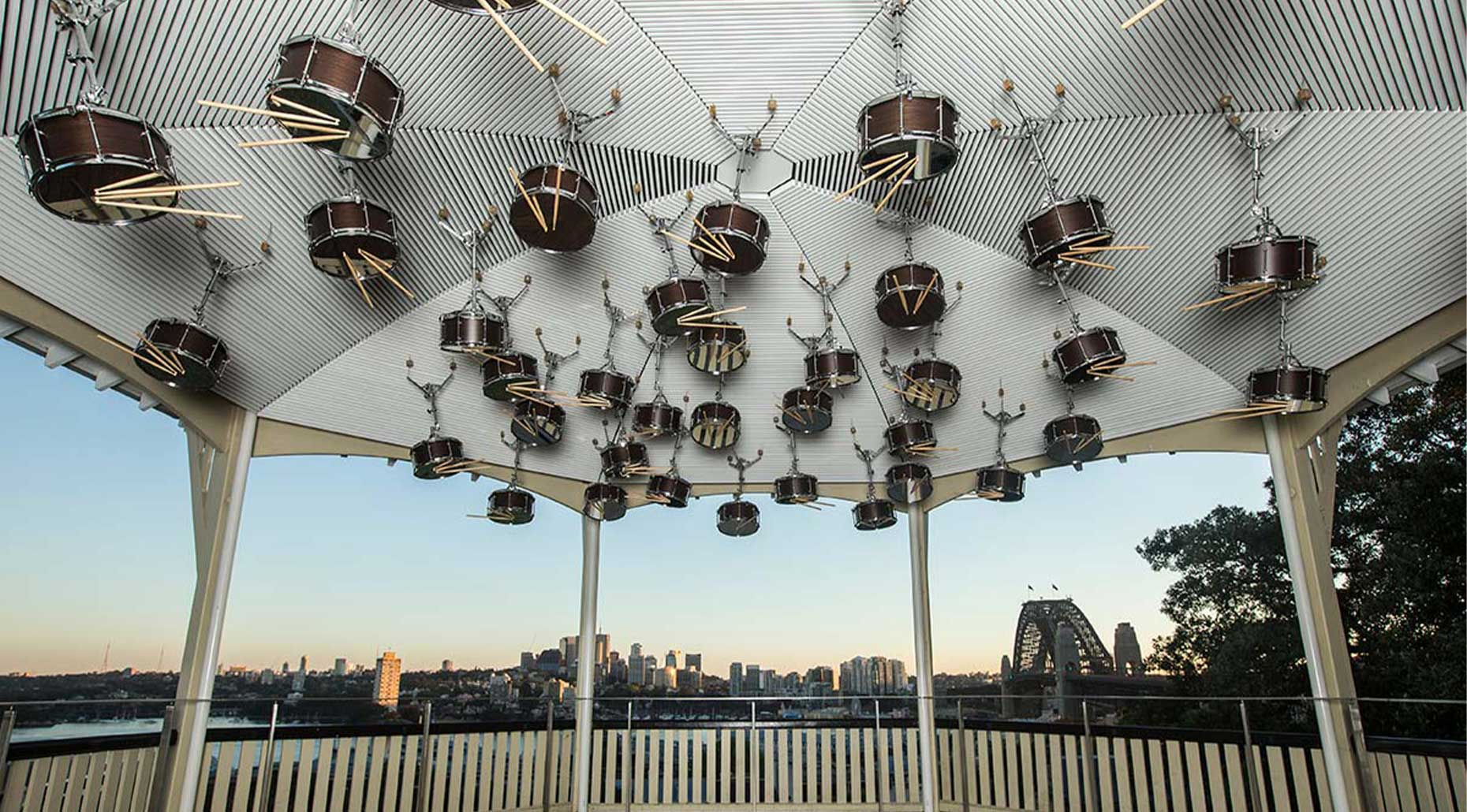Installation of rums and drum sticks at the ceiling of the gazebo on Observatory Hill by Anri Sala for Kaldor Public Arts. Image supplied by Julian Wessels.