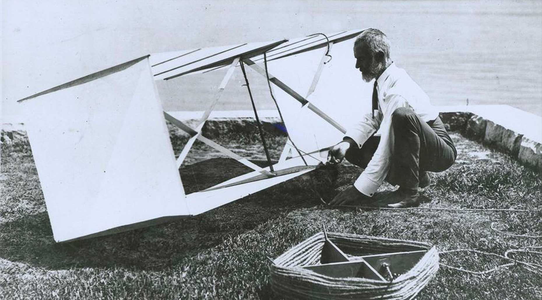 Photograph of Lawrence Hargrave kneeling beside box kite at Woollahra Point, print made circa 1977. Powerhouse Collection.