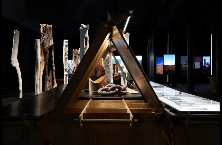 A frame structure in dark exhibition space.