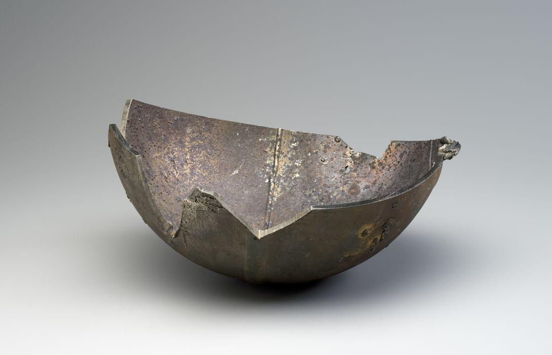A fragment from a USSR satellite, titanium/vanadium/aluminium, found NSW 1957-72. Powerhouse Museum.